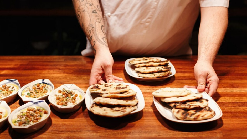 Charred pita and dip at Africola. Sit up at the bar and watch the chefs at work.