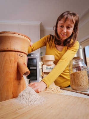Nerida Thompson mills wholegrain wheat at home.