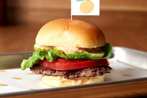 The Impossible Burger, made with a vegan meat-like patty and served at a number of restaurants, including Momofuku Nishi ...