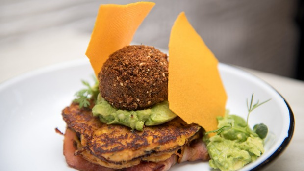 Truffled sweet potato and corn fritters with dukkha-coated son-in-law egg, smashed avo, bacon and corn tuille at Be the Duck.
