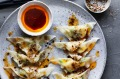 Kylie Kwong's scallop and ginger dumplings with Sichuan chilli dressing and Sichuan pepper and salt.