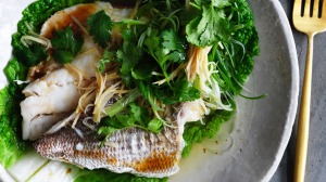 Kylie Kwong's aromatic steamed snapper fillets with ginger, spring onions and coriander.