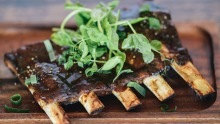 Half rack of slow-cooked pork ribs.