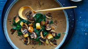 Lighten up: Brown mushroom and spinach soup with crunchy croutons.