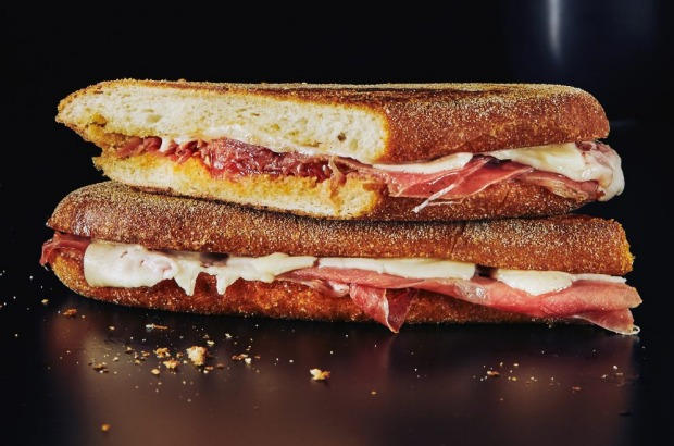 Darren Purchese's Spanish-inspired ham, cheese and tomato toastie, from his book 'Chefs Eat Toasties Too' <a ...
