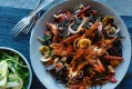 Squid ink pasta with vongole, chorizo and roasted prawn oil at Three Blue Ducks.