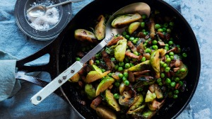 Brussels sprouts with bacon, peas and mint makes a meal almost all of itself.