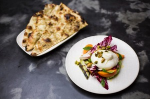 SYDNEY, AUSTRALIA - MAY 30: The clay oven flat bread, burrata, persimmon and grilled leeks served at Pheast in Waverley ...