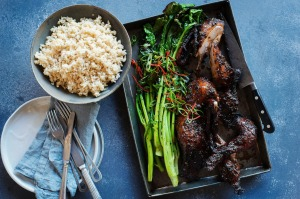 Twice-cooked sticky duck with charred Asian greens.