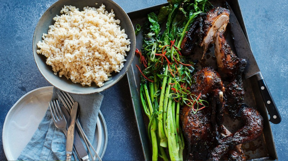 Twice-cook duck with charred Asian greens.