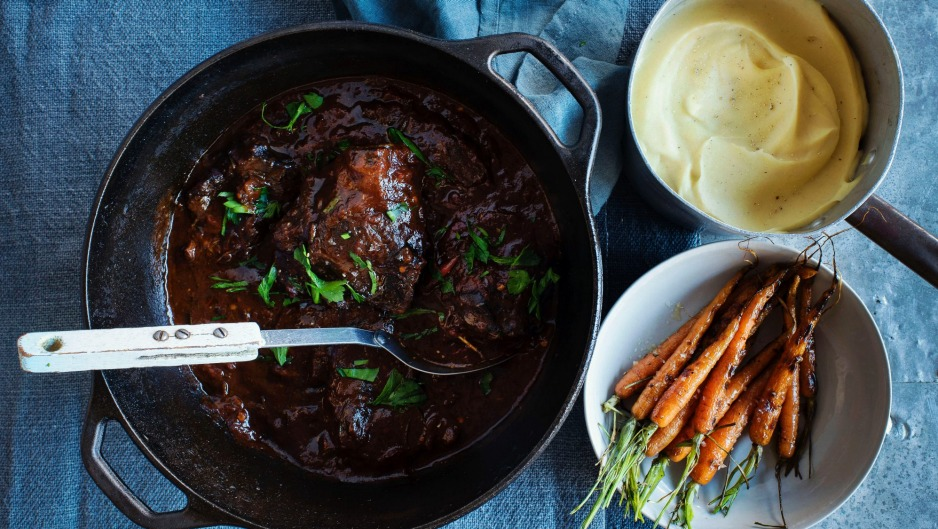 Braised beef cheeks with carrots and parsnip puree.