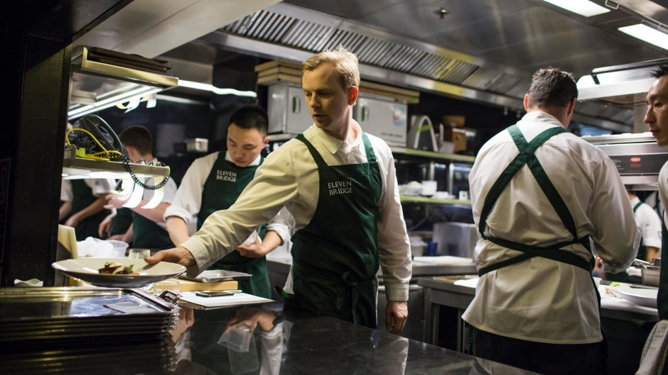 Chef Phil Wood works at the pass at Eleven Bridge in Sydney.