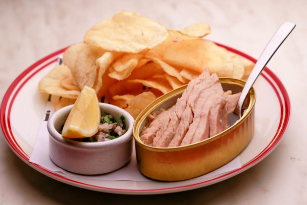 Tin of tuna belly with potato crisps at Neptune.