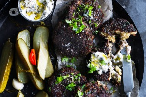 Pumpernickel pork patties with gherkin mayo and pickles.