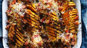 Butternut pumpkin wedges with cous cous and parmesan crust.