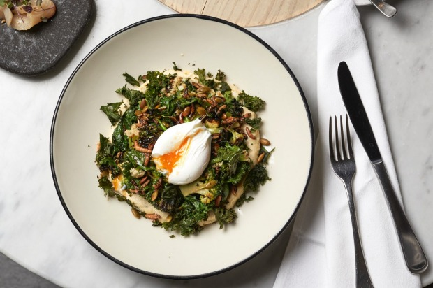 Kale and cauliflower salad, miso, almond, hummus, avocado, poached egg and puffed rice at Higher Ground.