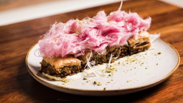 Baklava topped with a toupee of pink fairy floss.