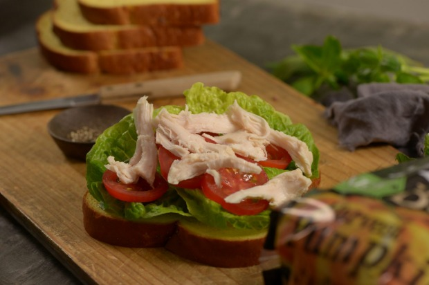 Chicken, baby cos, tomato: 1 slice AVB Pumpkin & Sunflower Seed bread, 50g poached chicken, 2 baby cos leaves, 1 small tomato