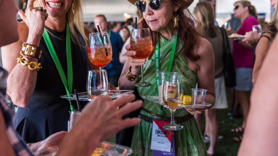 Festival goers sample food and drink at the annual Food and Wine Classic in Aspen, Colorado.