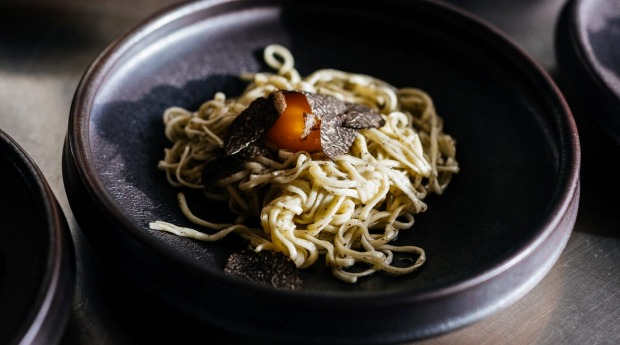 Tajarin pasta with truffle butter and truffled egg yolk at the Agrarian Kitchen.