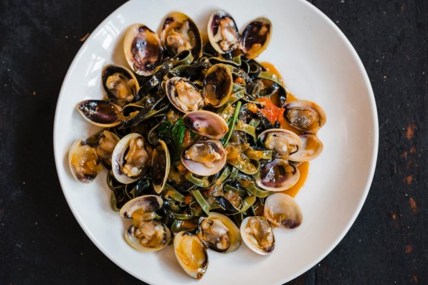 Saffron and squid ink linguine with Eyre Peninsula clams, tomato and basil at Lulu La Delizia.
