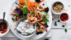 Coconut rice with quick pickled vegetables and prawn skewers.