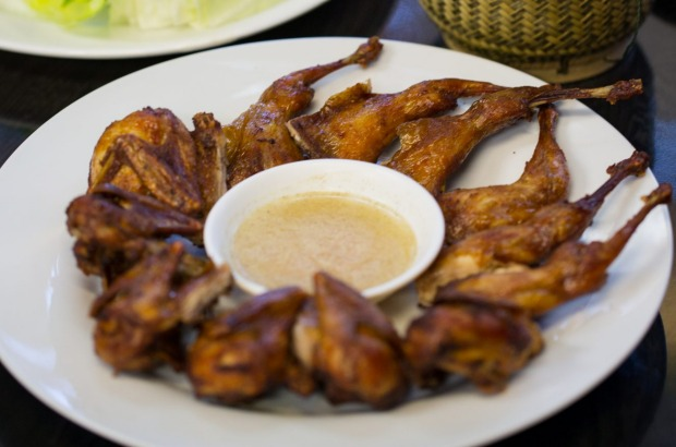 Fried quails and sticky rice at Lao Village.