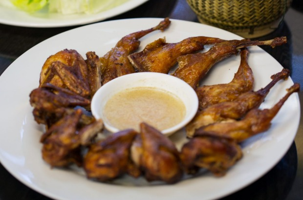 Fried quails and sticky rice $10 at Lao Village in Fairfield.