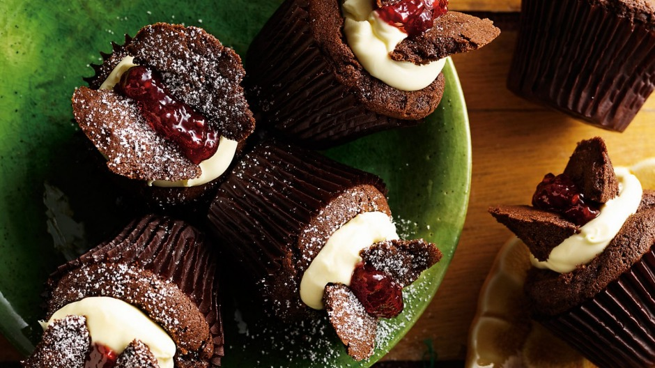 Chocolate butterfly cakes with jam and cream.
