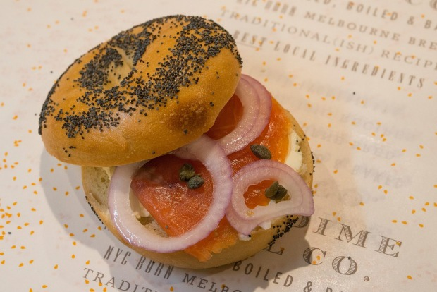 Smoked salmon, red onion, cream cheese and capers on a poppy-seed bagel at 5 & Dime.