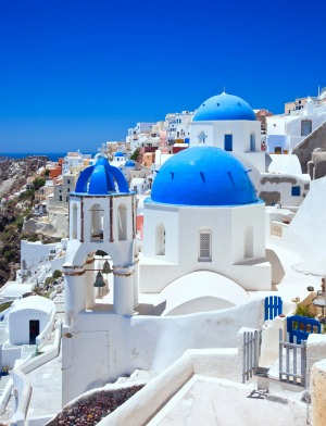 A church with blue domes in the village of Oia, Santorini.