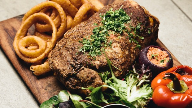 The slow cooked lamb shoulder with a side of onion rings.