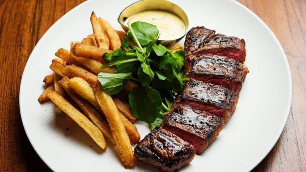 Steak frites with triple-cooked chips, watercress, and bearnaise.