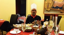 Anghiti Restaurant Chef with  his food