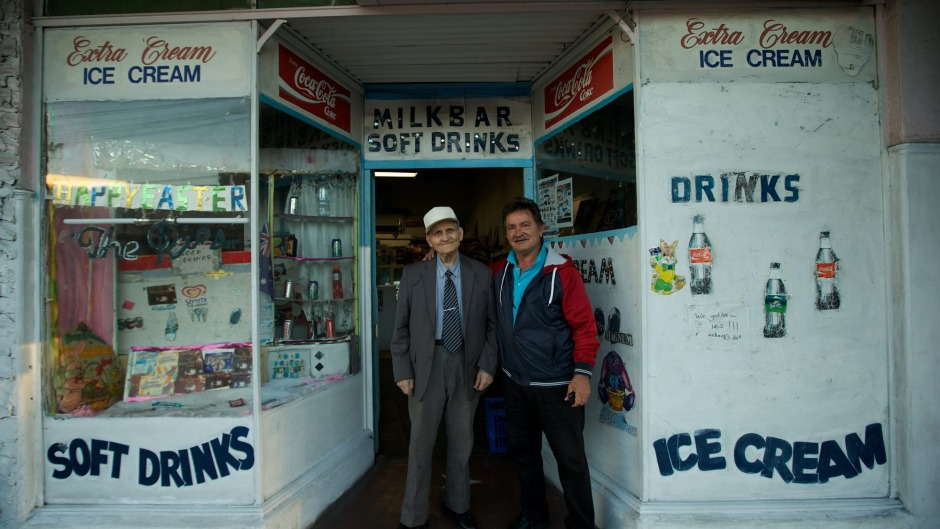 George Poulos with his son Nik in Summer Hill. George served his customers dressed in a suit and tie every day.