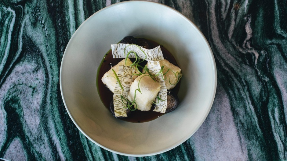 Fried tofu, pickled shiitake, bonito, soy, spring onion oil and sesame.