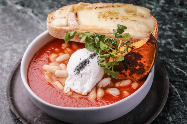 The wood-fired beans, pumpkin and cheesy toast served at Abacus cafe in South Yarra.