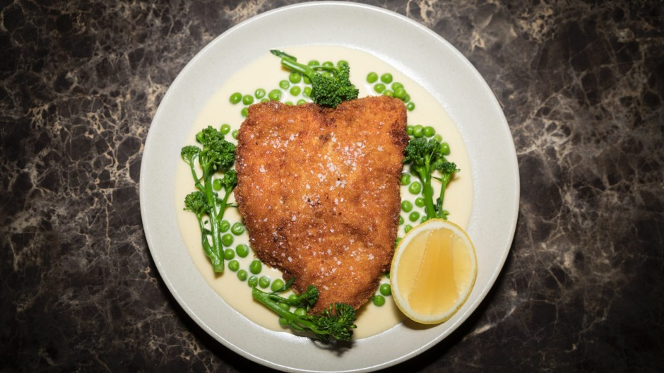 Chicken cotoletta, peas, broccolini and lemon parmesan cream.