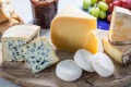 From left: Fourme d'Ambert blue-veined French cheese, Old Winchester firm pasteurized cheese, Picodon goat's milk cheese ...