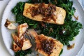 Salmon fillets with caramelised onions and wilted greens.