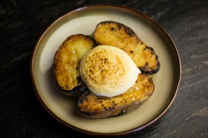 Royal blue potatoes topped with a cloud of mustard foam.