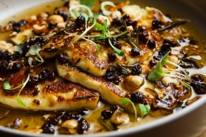 Grilled halloumi with honey, hazelnuts and currants.