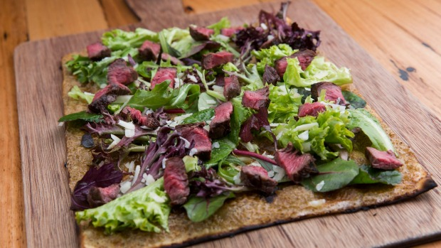 Steak and lettuce tarte flambe.