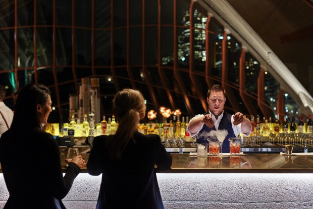 Pouring a drink at Bennelong bar.