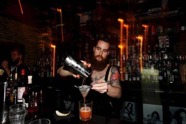 Preparing a cocktail at Ramblin' Rascal.