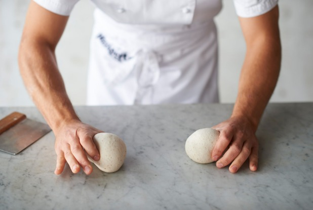 Shaping the dough step 5: Roll each ball gently on the work surface to make it even and round.