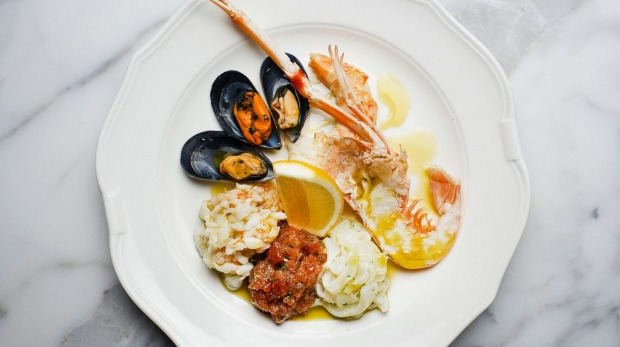 Seafood antipasto of raw and cooked scampi, crab, squid, prawns and mussels.