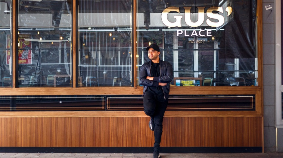 Owner Fish Zafar outside the new look Gus' Place on Bunda Street.
