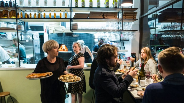 Prepare to queue for a table at Pizza Madre.