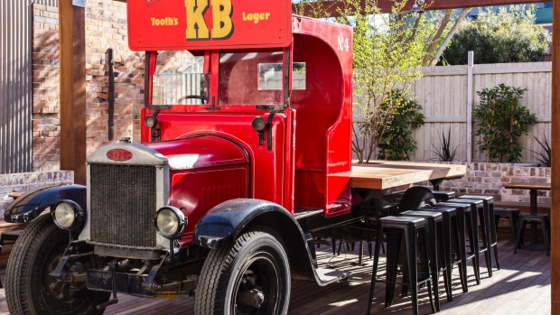 A 1926 beer delivery truck has been converted into a table.